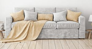Modern sofa upholstered with gray and beige fabric