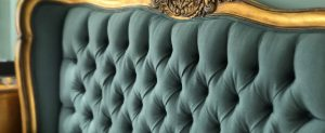 Green headboard upholstered with blur fabric