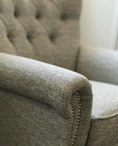 Armchair upholstered with gray fabric