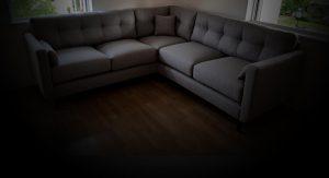 Dark fabric on upholstered corner sofa