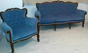 Classic sofa and armchair upholstered with blue fabric