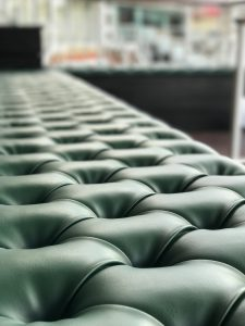 Green leather on upholstered seat