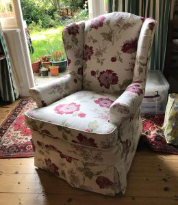Armchair upholstered with flower pattern fabric