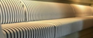 Upholstered black-white striped couch closer view