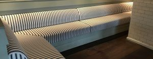 Upholstered black-white striped couch