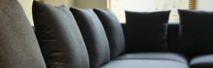 Gray cushions upholstered in fabric