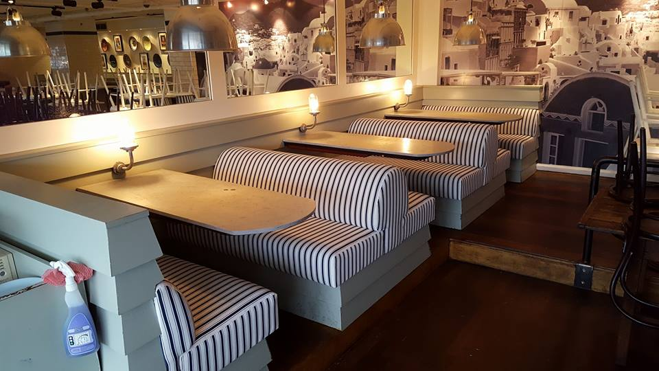 Restaurant seats upholstered with stripes fabric