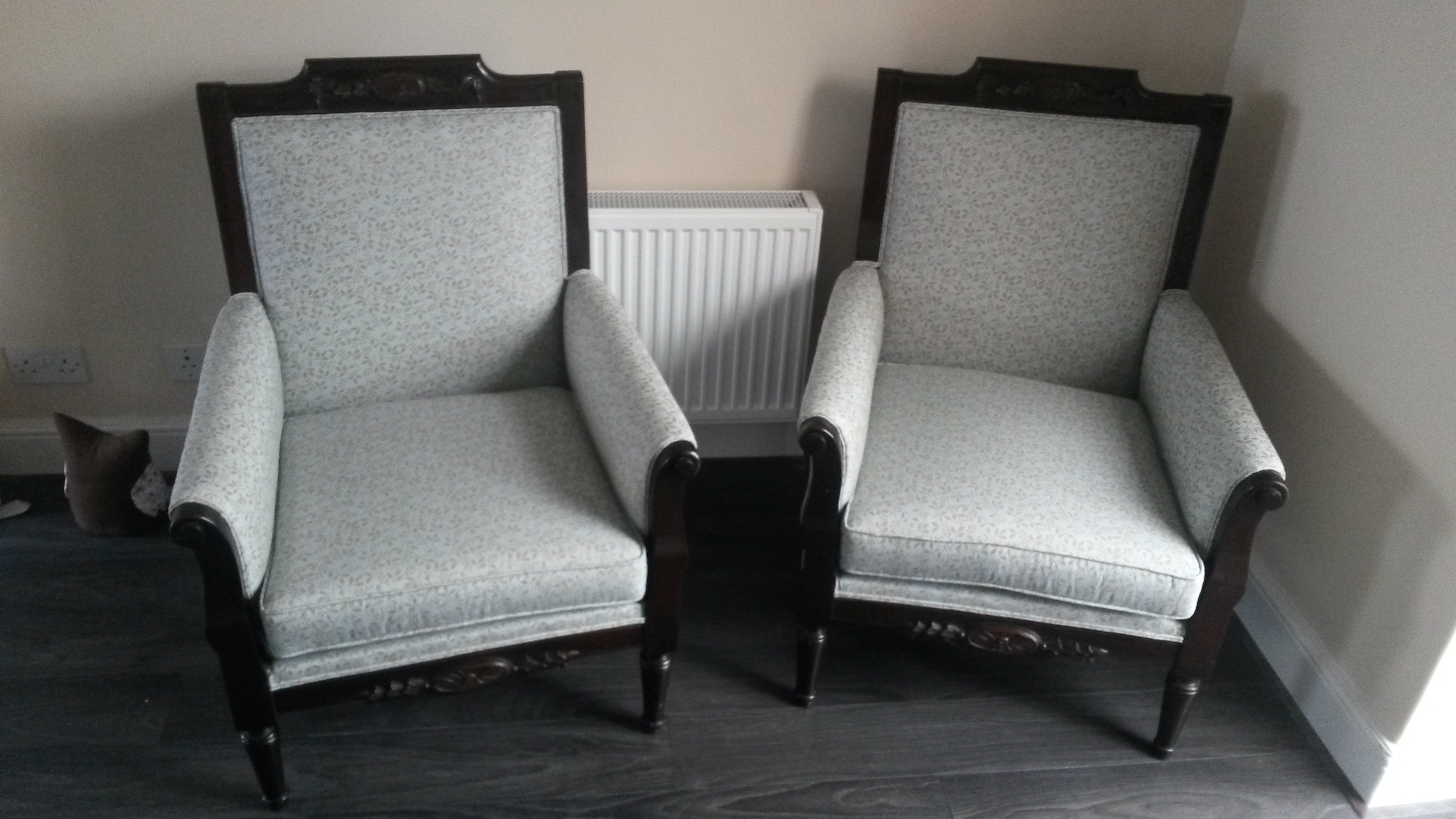 Two armchairs upholstered with gray fabric