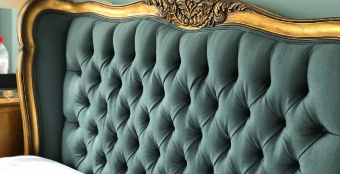 Golden frame green headboard upholstered with fabric
