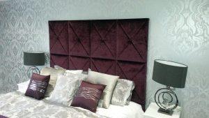 Bespoke headboard upholstered with dark fabric